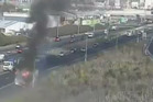 Still from traffic camera of a truck fire on the south-western motorway near Lambie Drive. Photo / NZTA