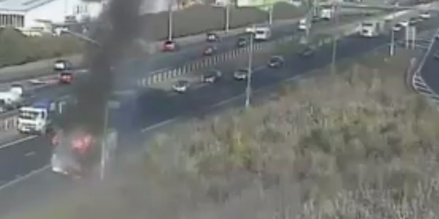 Loading Still from traffic camera of a truck fire on the south-western motorway near Lambie Drive. Photo / NZTA