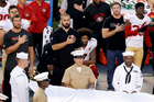 San Francisco 49ers quarterback Colin Kaepernick, middle, kneels during the national anthem before the team's NFL preseason football game against the San Diego Chargers. Photo / AP