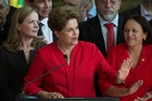 Dilma Rousseff vowed to return as she spoke to supporters outside the presidential residence after yesterday's decision. Picture / AP