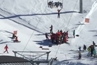 Screen grab from a video where a boy dangles from chairlift at Mt Hutt skifield and is rescued. Photo / Facebook/Tony Kramers