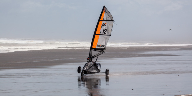 Blokarting on Muriwai Beach. Photo / Creative Commons image by Flickr user russellstreet