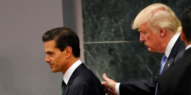 President Enrique Pena Nieto and Donald Trump met in Mexico City but did not agree on who would pay for any border wall. Picture / AP