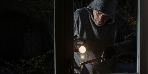 It's a great idea to have cops attend every burglary, but where are they to come from? Photo / Getty Images