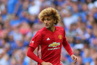 Manchester United midfielder Marouane Fellaini has been praised for helping a supporter in distress during a game against Hull City on the weekend. Photo / Photosport