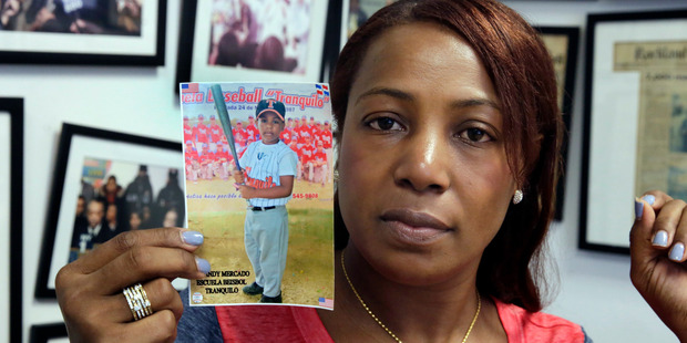 Maribel Martinez holds a photo of her son Andy at her attorney's office in New York. Photo / AP