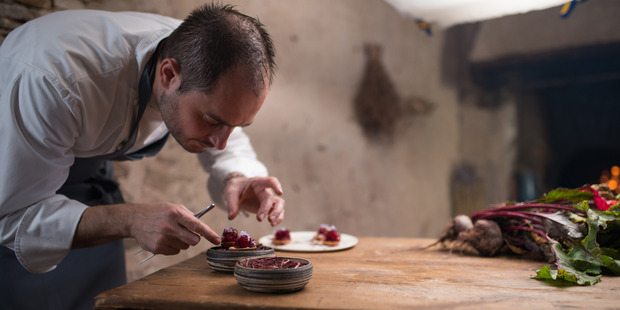Chef Alexandre Couillon plates up a dish in an episode of Chef's Table France.