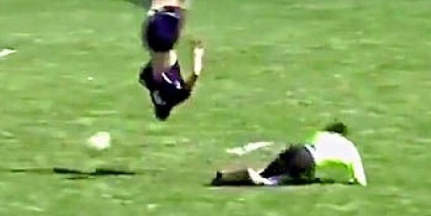 Loading Dylan Prichett-Ettner of the Columbine boys football team in Colorado had nowhere to go but up, over, upside down, and around. Photo / YouTube.