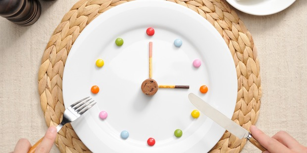 Adults should never eat within two hours of bedtime - and ideally nothing after 7pm. Photo / Getty