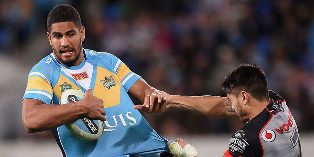 Nene MacDonald of the Titans is tackled by Shaun Johnson of the Warriors. Photo / Getty Images