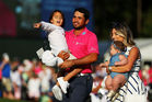 Jason Day of Australia celebrates with son Dash, wife Ellie and daughter Lucy after winning during the final round of THE PLAYERS Championship. Photo / Getty Images