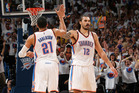 Steven Adams and Andre Roberson high five each other during a game against Golden State. Photo / Getty Images