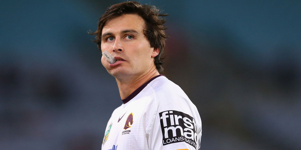 Lachlan Maranta watches on during the match between the Rabbitohs and the Broncos. Photo / Getty