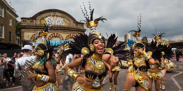 Performers take part in the Notting Hill Carnival. Photo / Getty