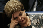 Suspended President Dilma Rousseff sits during a question from a Senator on the Senate floor during her impeachment trial on August 29, 2016. Photo / Gettyr