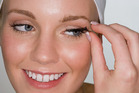 Some make-up professionals swear by applying falsies under their natural lashes rather than on top. Photo / Getty Images