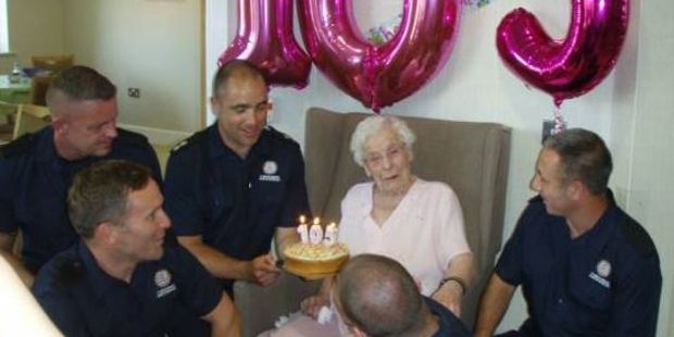 Ivy Smailes was delighted by a crew of local firefighters at her 105th birthday party. Photo / Facebook