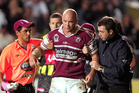Manly's Ben Kennedy is helped from the field after getting concussed in 2005. Photo / Photosport