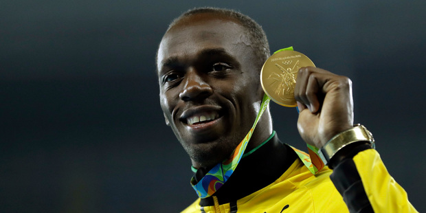 Usain Bolt with his 200m gold medal from the 2016 Rio Olympics. Photo / AP
