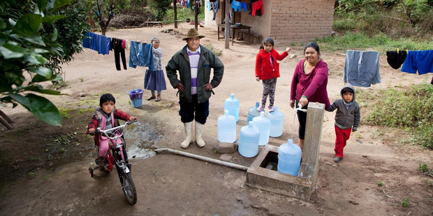 Rene Visalla (third from left) says running water and a toilet have made life much safer for his  family as they often encountered snakes while relieving themselves in the bush. Photo / Unicef