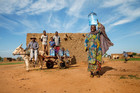 Foure Moussa travels the 2km to the nearest borehole at night to avoid long queues. Photo / Unicef