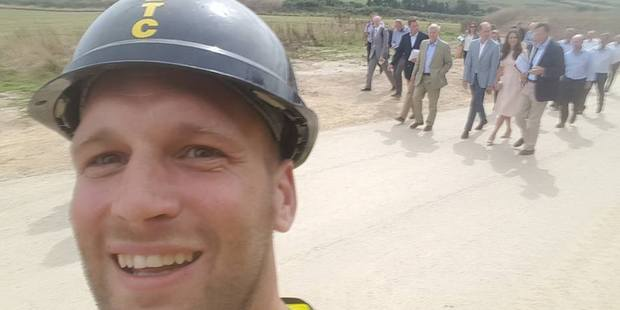 A construction worker snaps a selfie with Prince William and Catherine, as they visit a housing project site in Newquay, United Kingdom. Photo / Facebook, Sam Wayne