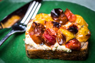 Blistered cherry tomatoes and ricotta on toast. Photo /  Greg Bowker