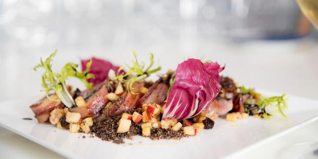 Pork loin with lemongrass glaze, coffee soil & apple, prune, walnut salad. Photo / Michael Craig