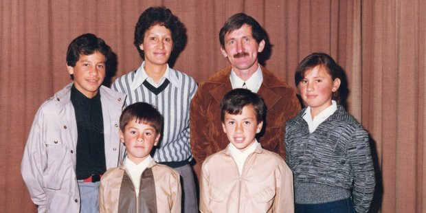 Actor Tammy Davis and as a youngster with his parents and siblings.
