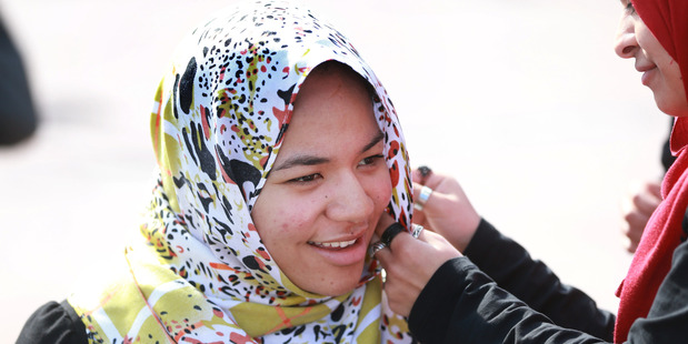 Islam Open Day at Aotea Square Auckland today. Pictured is Ofa Vea from Papatoetoe trying on a Hajib. pHOTO / Doug Sherring
