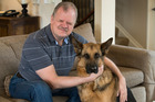 Clive Lansink (who is blind) with his guide dog Yorrick. Photo / Brett Phibbs