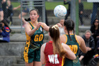 Whanganui High School goal defence Kahu Sturmey gets the ball away at the lower North Island secondary schools netball tournament at Laird Park yesterday. Photo/ Bevan Conley