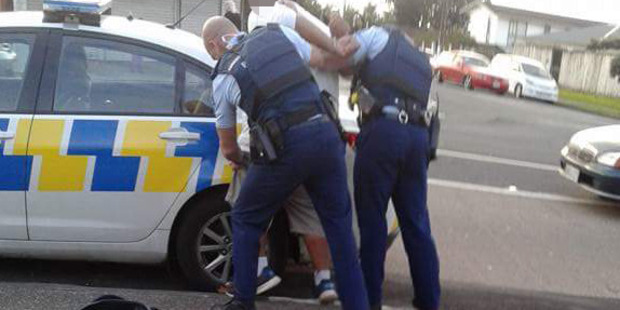 Police detain a suspect following a brawl at the Mangere branch at KFC. Photo / via Facebook