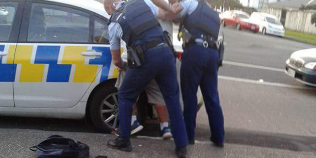 Police detain a suspect following a brawl at the Mangere branch of KFC. Photo / Supplied