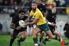 Quade Cooper gets lined up by All Blacks centre Malakai Fekitoa. Cooper has been a target for New Zealand rugby fans, which is great for the game. Photo / Photosport.nz