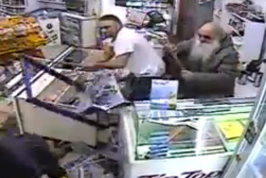 A father and son produced a hockey stick and table leg from behind the counter and fought back after two masked robbers attacked their dairy.
