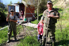 Bradie Alabaster, 39, his daughter Taylor and friend Curtis Parker in front of the whitebaiting hut on Upokongaro Creek. Photo/Stuart Munro