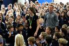 Olympic bronze medalist Eliza McCartney and her coach Jeremy McColl walking through Belmont Intermediate School hall. Photo / Jason Oxenham