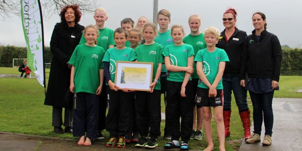 Toko School enviro-leaders pictured with the team from Taranaki Enviro-Schools with their award and new flag.