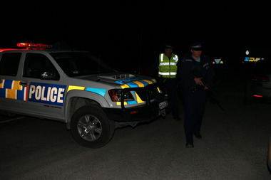 Police set up a road block on the Kaiwaka-Mangawhai road north of Auckland as they search for Joshua Kite. photo / Doug Sherring