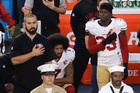 San Francisco 49ers quarterback Colin Kaepernick kneels during the national anthem. Photo / AP
