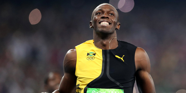 Jamaica's Usain Bolt celebrates as he crosses the line to win gold in the men's 100-meter final during the athletics competitions of the 2016 Summer Olympics. Photo / AP.