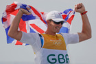 Britain's Giles Scott celebrates winning the men's Finn sailing race at the 2016 Olympics. Photo / AP