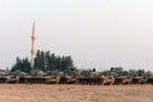 Turkish tanks stationed near the Syrian border, in Karkamis, Turkey. Photo / AP