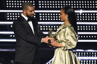 Drake, left, presents the Michael Jackson Video Vanguard Award to Rihanna at the MTV Video Music Awards. Photo / AP