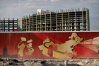 A wall with symbols of China partially blocks the view of the Resorts World property in Las Vegas. The Asian-themed casino property is projected to open in 2019. Photo / AP