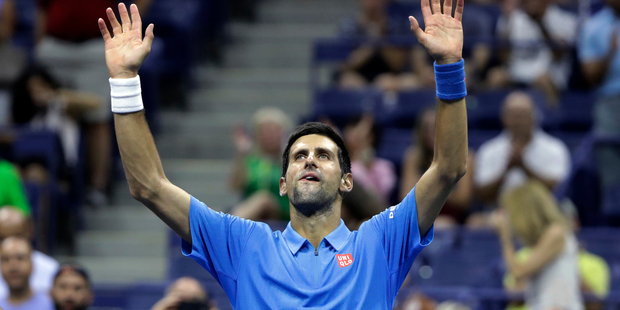 Novak Djokovic, of Serbia, waves after defeating Jerzy Janowicz, of Poland, during the first round of the US Open. Photo / AP