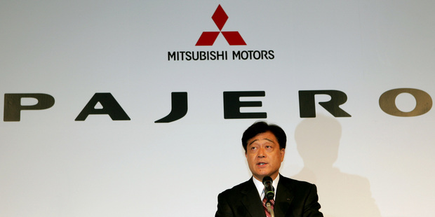 Mitsubishi Motors President Osamu Masuko at a 2006 press conference. It appears more of the company's cars do not live up to claimed mileage performance. Photo / AP