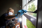 Scene of crime officer Jayne Simpson investigates a burglary at an Avondale property in March. Photo / Jason Oxenham.