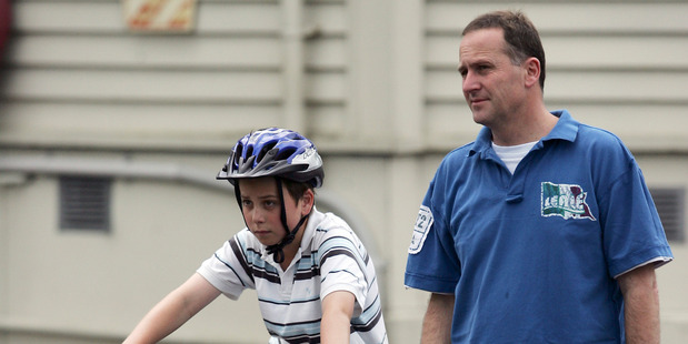 Max Key (11) with his father John Key in Parnell. Photo / Michael Craig